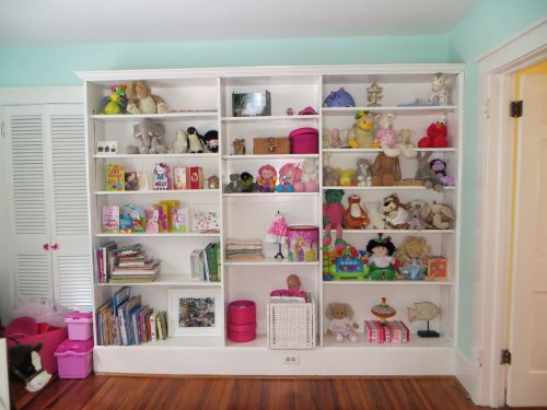 These shelves make the third bedroom perfect for books or toys!