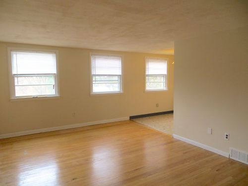 The bright and spacious great room has beautifully refinished oak floors...