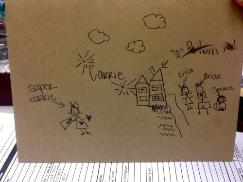 "And I LOVE how they drew a picture of ""Super Carrie"" on my card - check out my cape!"