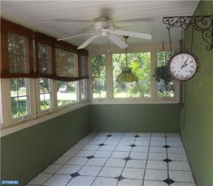 Before with drop ceiling, painted paneling & an old ceiling fan...
