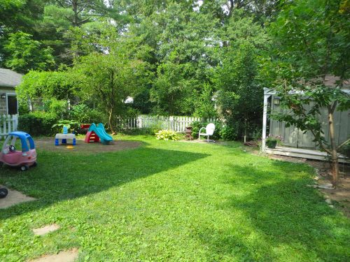 Outside there is a level backyard which is just the right size to enjoy but not enough to make lawn care a chore! (The area with the toys is a round brick patio!)