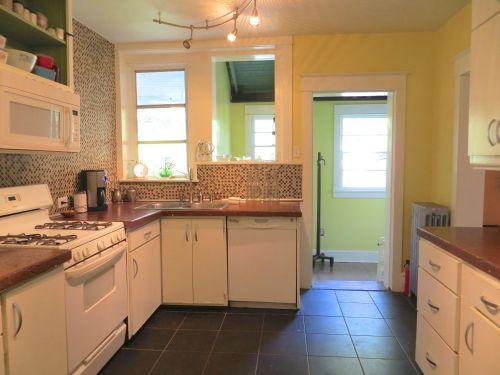 The kitchen has sleek concrete countertops...