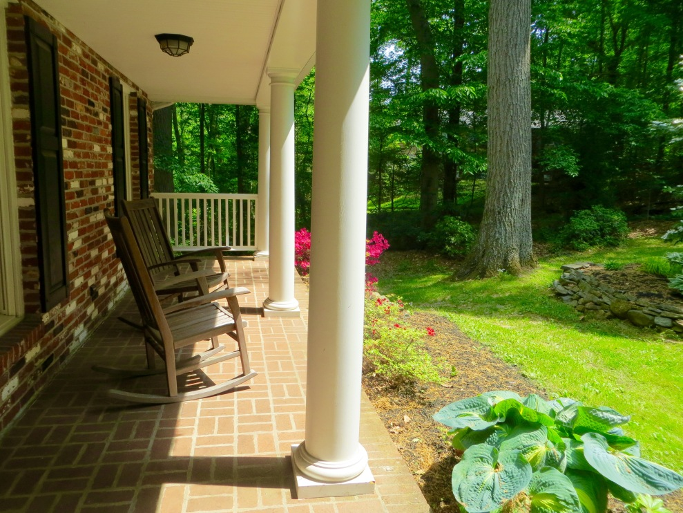 ...the open front porch, overlooking the knoll.